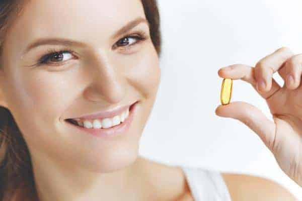 Uống dầu cá omega 3 6 9 giúp làm đẹp da, chắc khỏe tóc móng